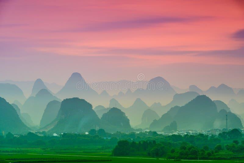 Karst Mountains of China. Guilin, China karst mountains landscape at dusk royalty free stock photo