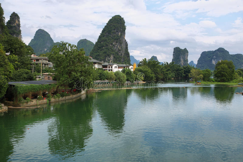 Karst mountains reflected in Yulong river. Near Yangshuo, Guanxi province, China royalty free stock images