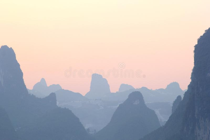 Landscape with mystic Karst mountains (Unesco) in Xingping,China. Karst mountains in Xinping near Yangshuo and Guilin, China. Province Guangxi. These stock images