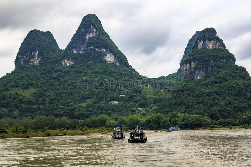 Karst peaks in Xingping Town and pleasure boat on the Li River stock image