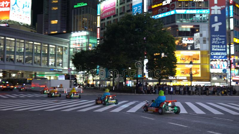 Kart de Mario que corre no cruzamento de Shibuya imagens de stock royalty free