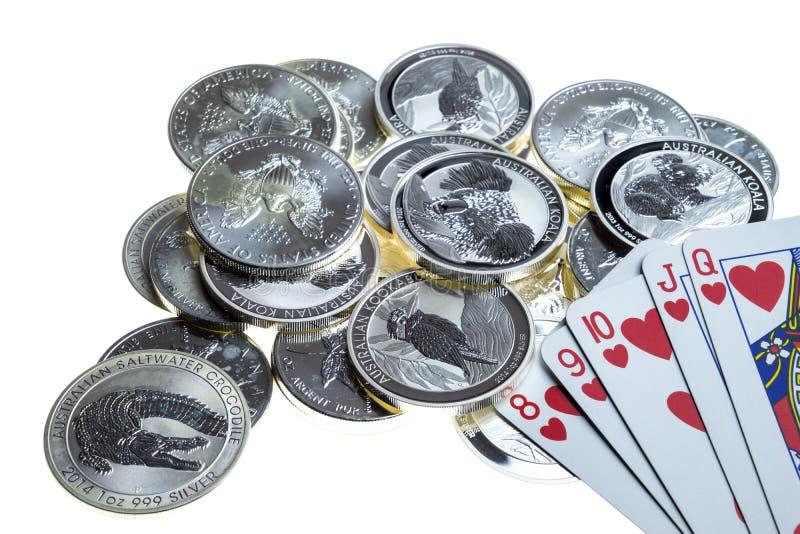 Karta do gry i srebne monety zdjęcie stock