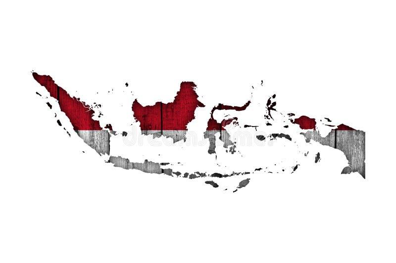 Karte und Flagge von Indonesien auf verwittertem Holz stockbild