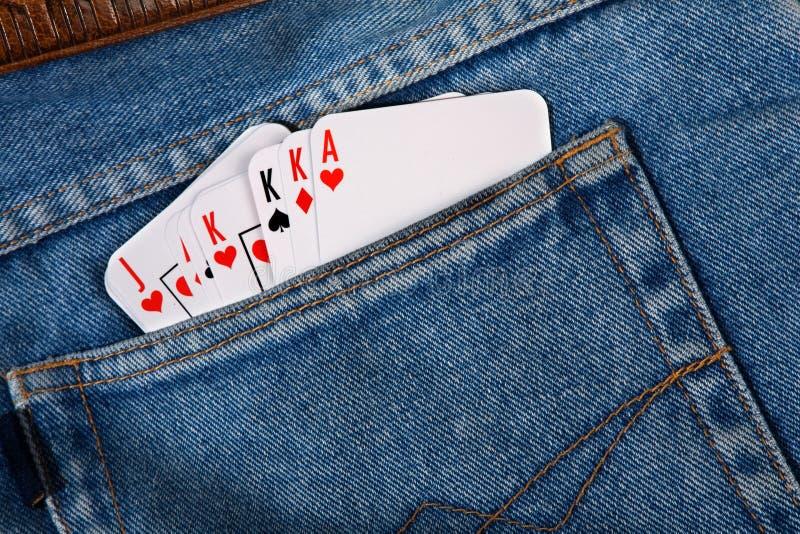Karten in den Taschenjeans lizenzfreies stockfoto