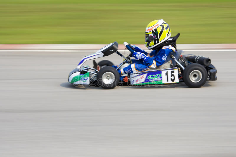 Karting Action (Blurred). Image of a go-kart racer competing at the KKS-AAM Malaysian Kart Championship 2009, held at Sepang International Karting Circuit stock photos