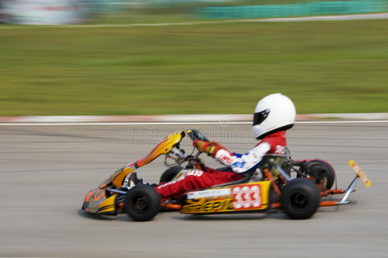 Karting Action (Blurred). Image of a go-kart racer competing at the KKS-AAM Malaysian Kart Championship 2009, held at Sepang International Karting Circuit royalty free stock image