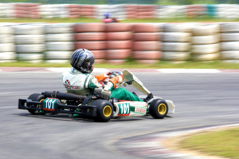 Karting Action (Blurred). Image of a go-kart racer competing at the KKS-AAM Malaysian Kart Championship 2009, held at Sepang International Karting Circuit stock photography