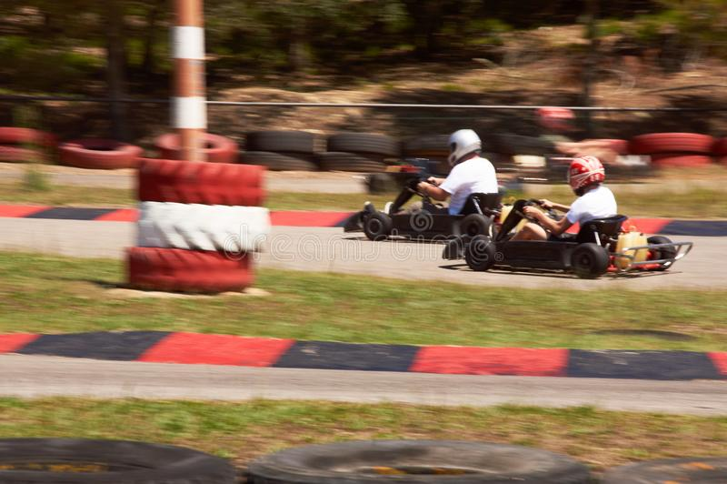 Karting Race speed track. Karting aka karting is the part of motorsport where racers compete with small, motorized vehicles called karts on specially-built kart stock images