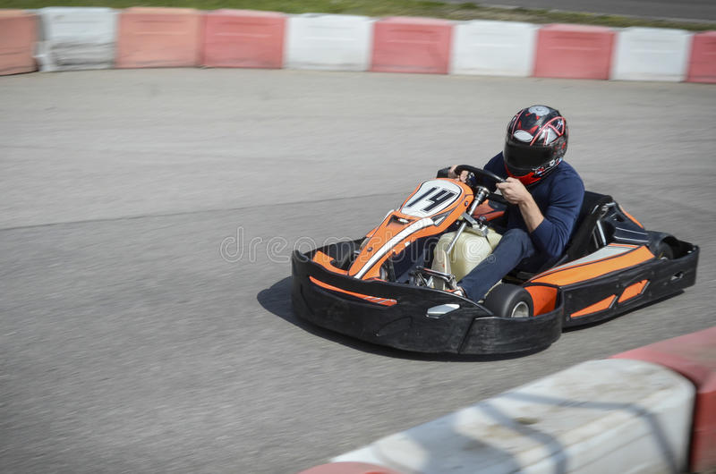Karting. Fast Driving man in a kart royalty free stock photos