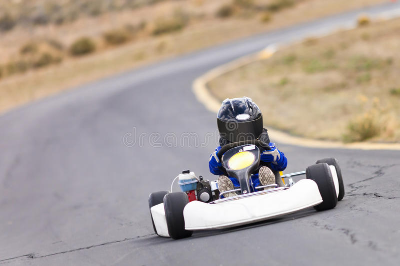Karting. A karting racer in a kart on a track royalty free stock images