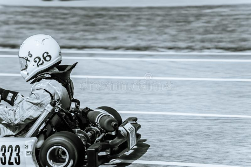 Karting. Racing Kart numbers 323 and 104 royalty free stock images