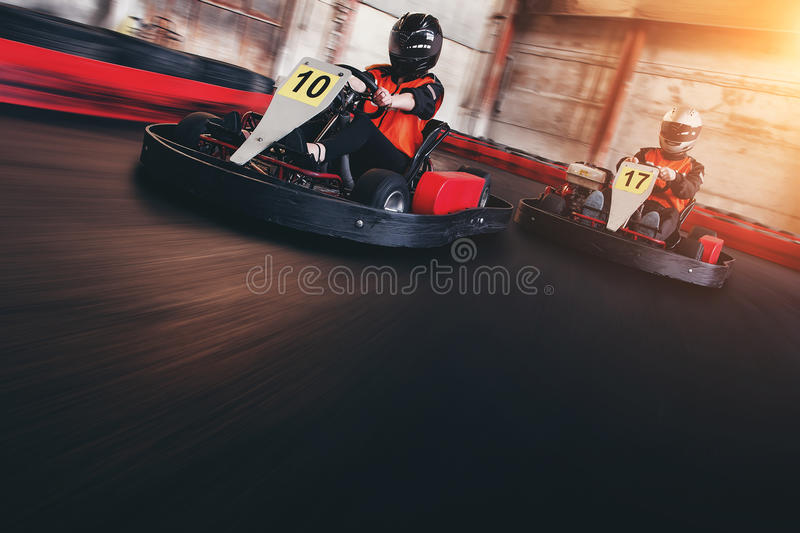 Karting speed rive indoor race opposition race stock photography