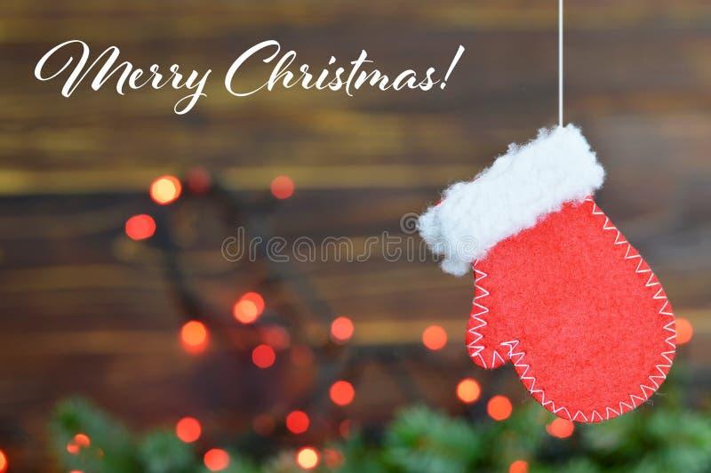 Kartka bożonarodzeniowa z Bożenarodzeniową rękawiczką fotografia royalty free
