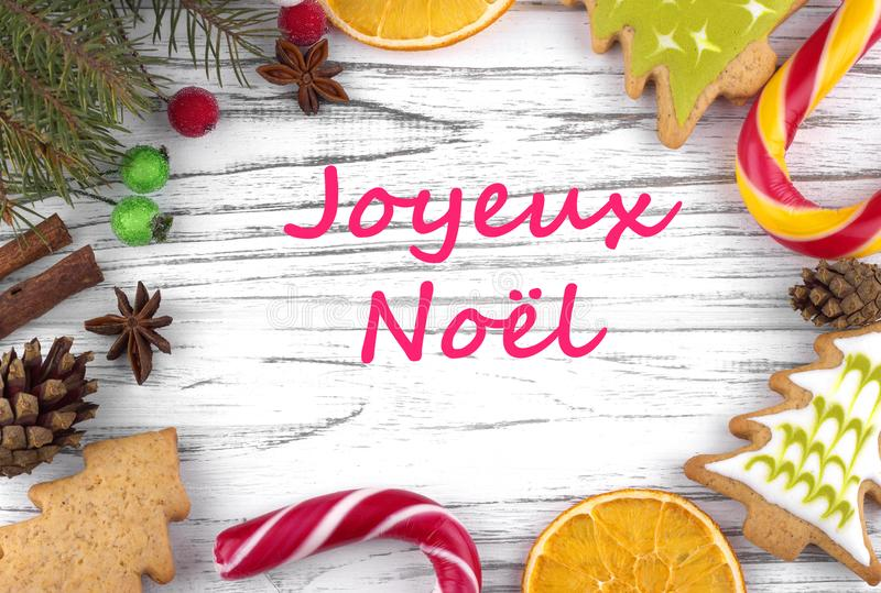 Kartka z pozdrowieniami z tekstów Wesoło bożymi narodzeniami w Francuskim fotografia stock