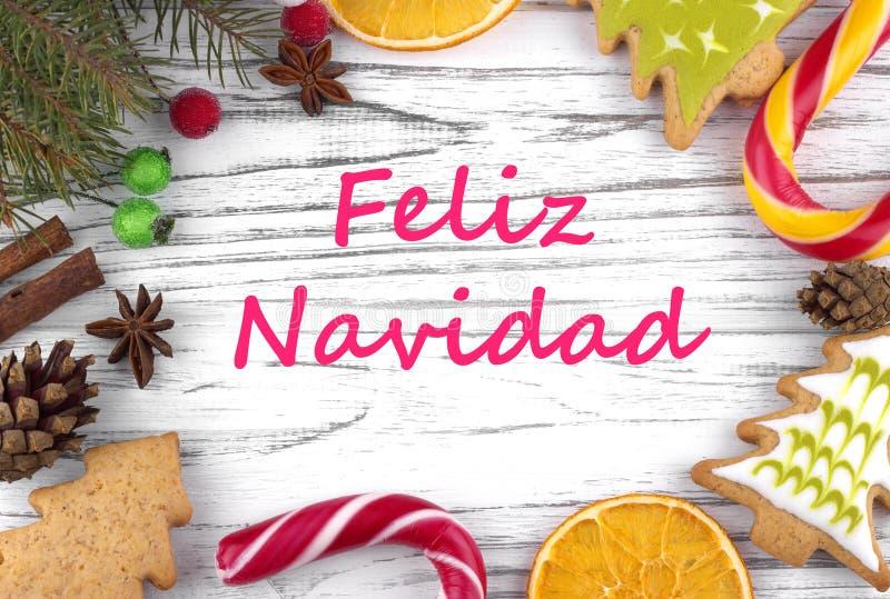 Kartka z pozdrowieniami z tekstów Wesoło bożymi narodzeniami w hiszpańszczyznach zdjęcie stock