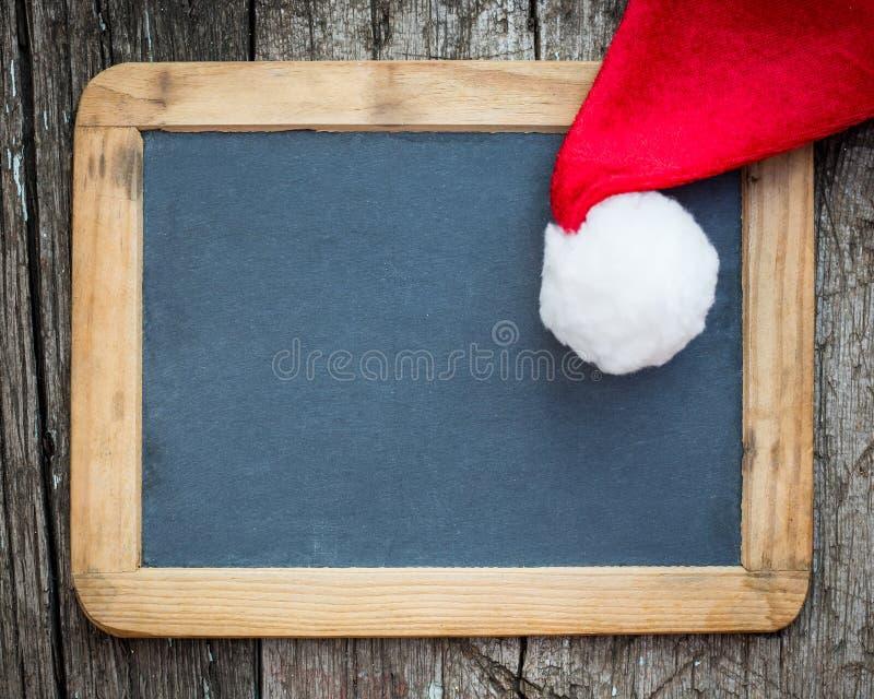Kartki bożonarodzeniowa puste miejsce z Santa kapeluszem obrazy royalty free