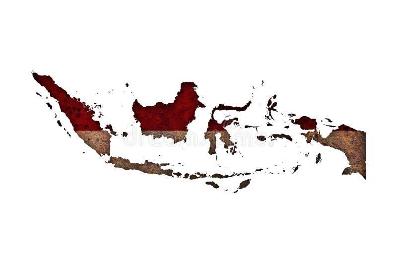 Kartlägga och flaggan av Indonesien på rostig metall royaltyfri fotografi