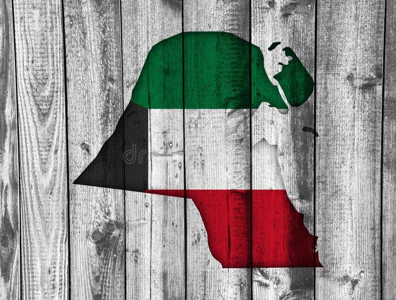 Kartlägga och flaggan av Kuwait på ridit ut trä royaltyfria foton