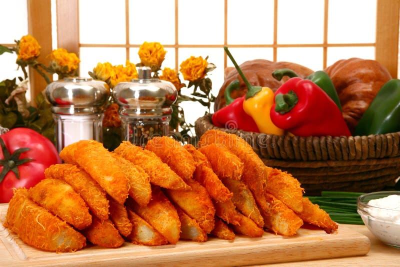 Kartoffel-Keile lizenzfreies stockfoto