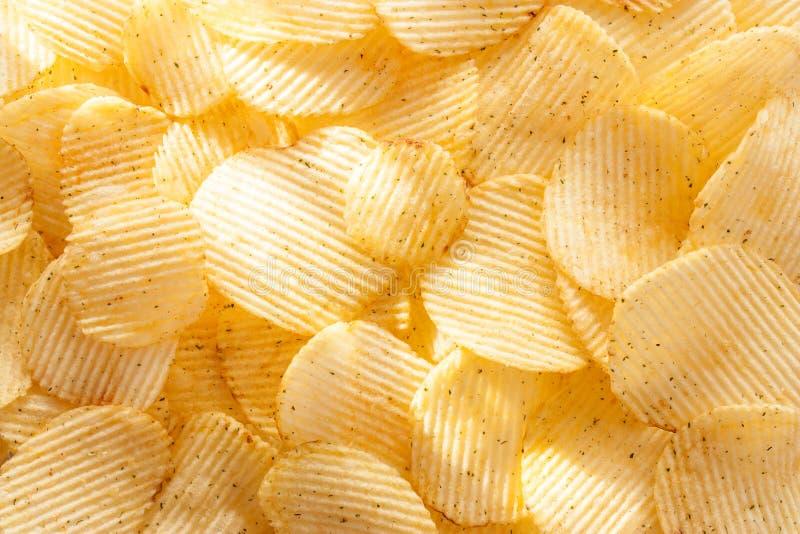 Kartoffelchiphintergrund im Sonnenlicht lizenzfreies stockfoto
