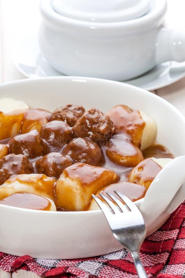 Kartoflane kluchy z mięsnymi klopsikami zdjęcie royalty free