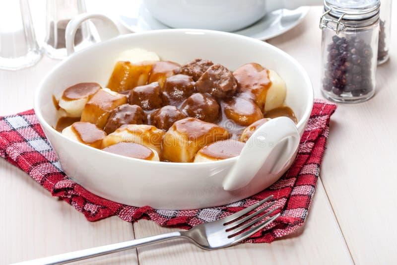 Kartoflane kluchy z mięsnymi klopsikami obrazy stock