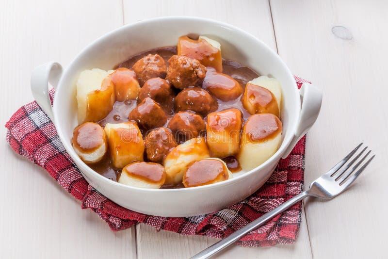 Kartoflane kluchy z mięsnymi klopsikami fotografia royalty free