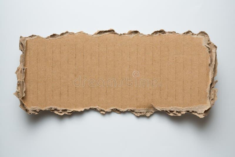 Karton gescheurd stuk royalty-vrije stock fotografie