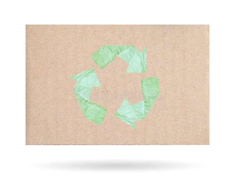 Karton met een kringloopdiesymbool, op een witte achtergrond wordt geïsoleerd stock foto's