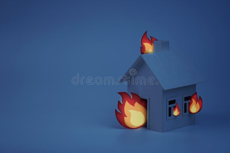 Kartonhuis met document brand, concept, nacht wordt aangestoken die stock foto