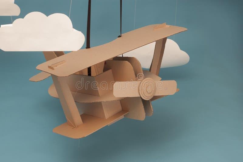 Kartonvliegtuig stock illustratie