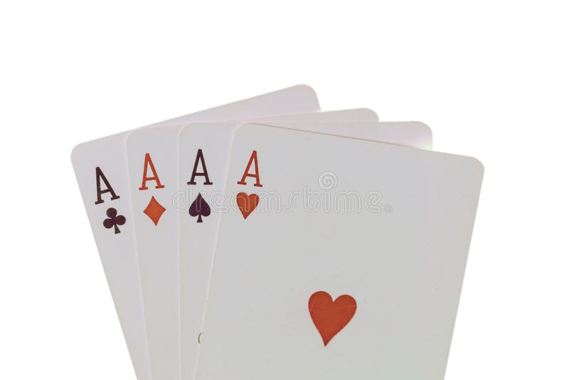 Karty do gry, grzebak, kasyno as tło cztery odizolowywał biel obraz royalty free