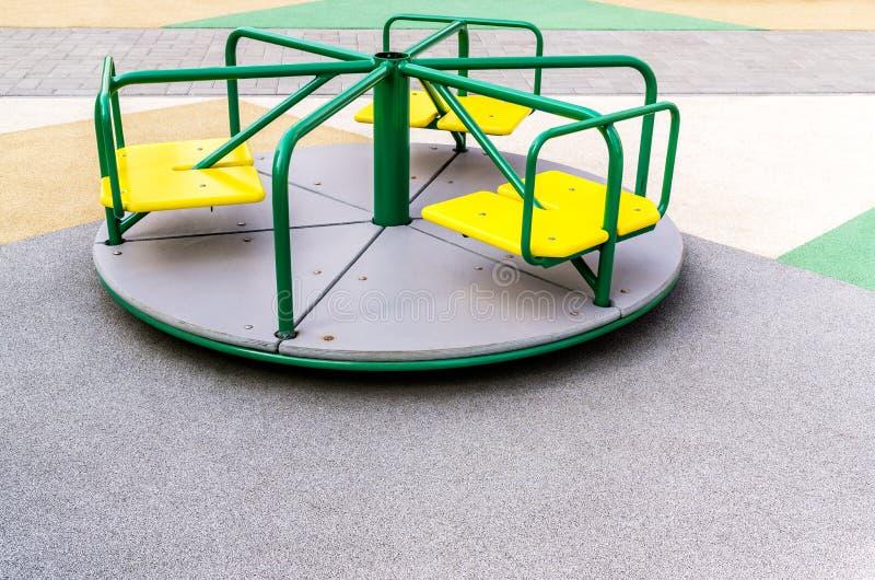 Karusell på lekplats arkivbild