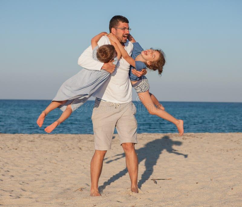 Karussell-Vater Kids Beach lizenzfreie stockfotos