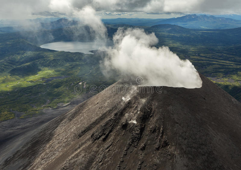Karymsky is an active stratovolcano. Kronotsky Nature Reserve on Kamchatka Peninsula. View from helicopter stock photo