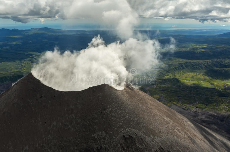 Karymsky is an active stratovolcano. Kronotsky Nature Reserve on Kamchatka Peninsula. View from helicopter stock image