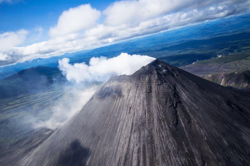 Karymsky volcano. Kronotsky Nature Reserve on Kamchatka. Top view. Close-up. Karymsky volcano. Kronotsky Nature Reserve on Kamchatka. Close-up. Top view stock image