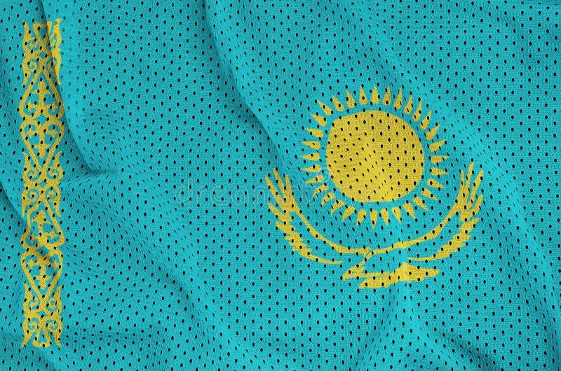 Kasakhstan flagga som skrivs ut på ett fab ingrepp för polyesternylonsportswear arkivfoton