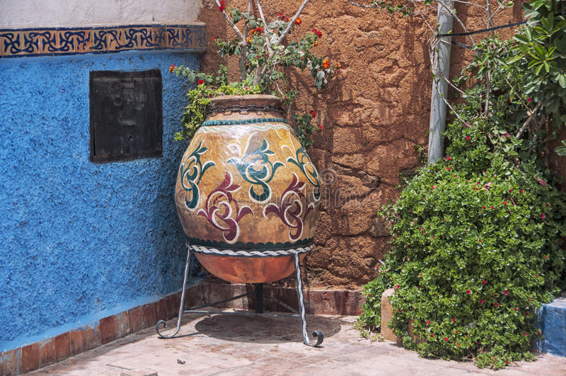 Kasbah of the Udayas. Big flower jar in the streets of Kasbah of the Udayas in Rabat. The capital of Morocco has UNESCO World Heritage Status and very famous royalty free stock photography