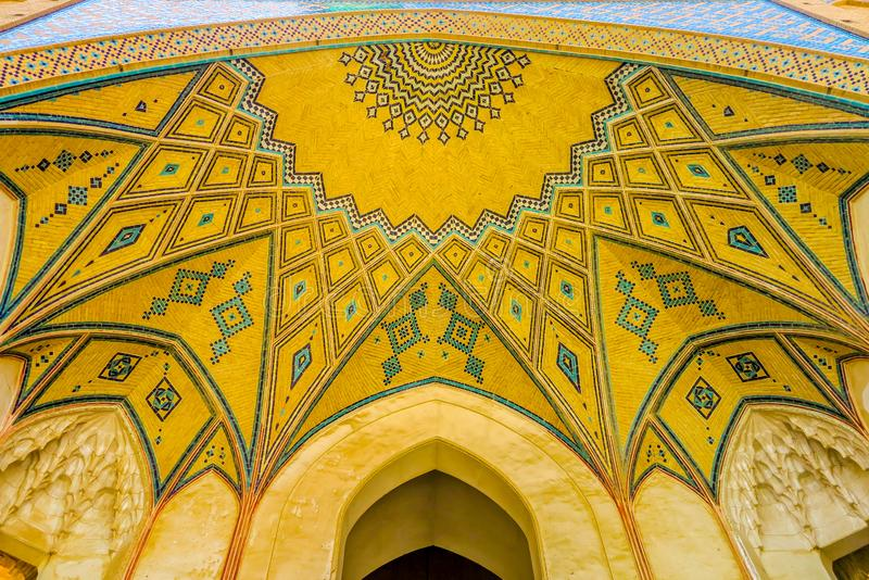 Kashan Agha Bozorg Mosque 07. Kashan Agha Bozorg Mosque Picturesque Breathtaking Yellow Colored Tiles Ceiling Gate stock photography