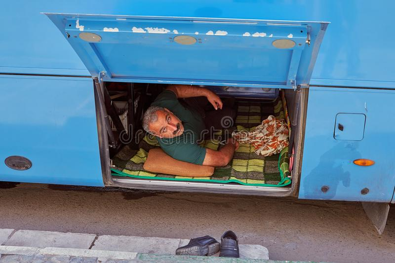 Iranian man in the trunk on the bus, Kashan, Iran. royalty free stock images