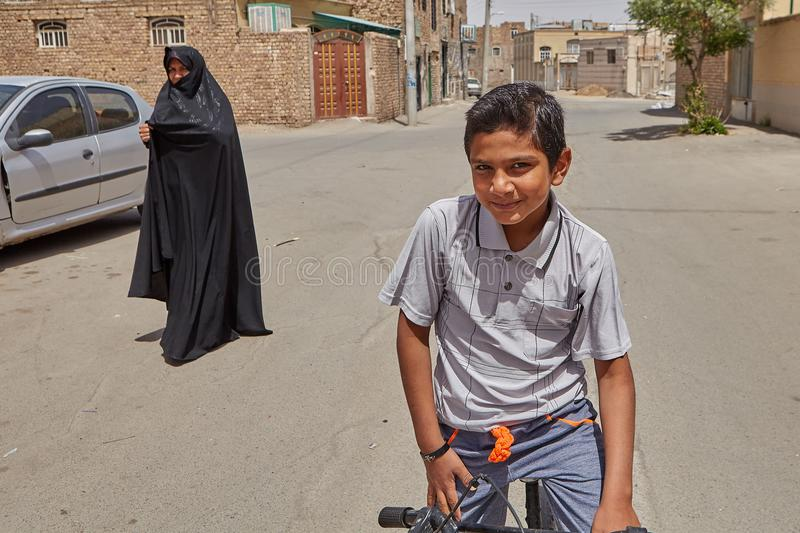 Iranian boy 12 years old posing for photograph, Kashan, Iran. Kashan, Iran - April 27, 2017: A portrait of an unknown Iranian teenager, about 12 years old royalty free stock photography