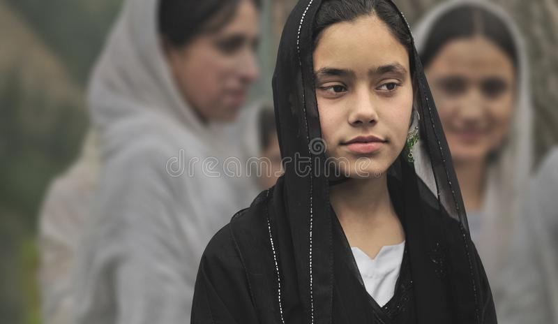Kashmiri girl who wears a black veil from Srinagar royalty free stock images
