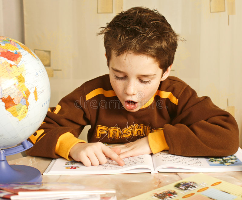 Kaspy spik. Young boy learns to spell stock photo