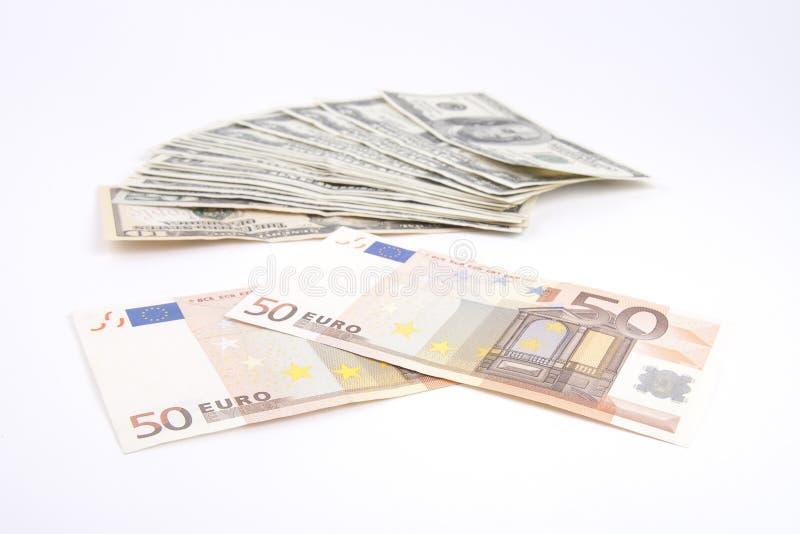 Kassa av US dollar och euro fotografering för bildbyråer