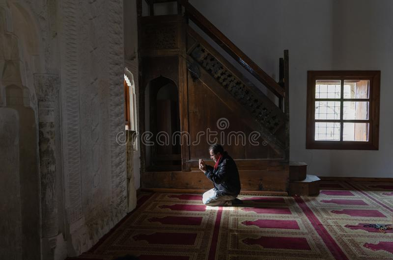 Muslim man praying in mosque royalty free stock image