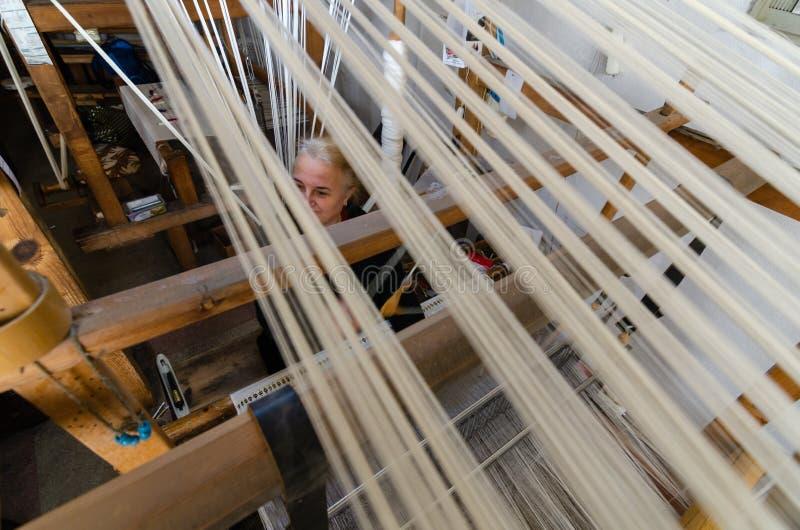 Traditional hand weaving in the Kastamonu in Turkey. Kastamonu,TURKEY-November 05,2017: Woman working at the loom. Turkey national crafts, top view royalty free stock image
