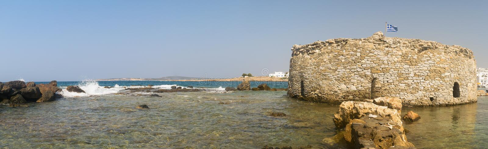 Kastelli castle of Paros island in Greece. An old Venetian fortress at Naoussa village. Panoramic view. royalty free stock photo
