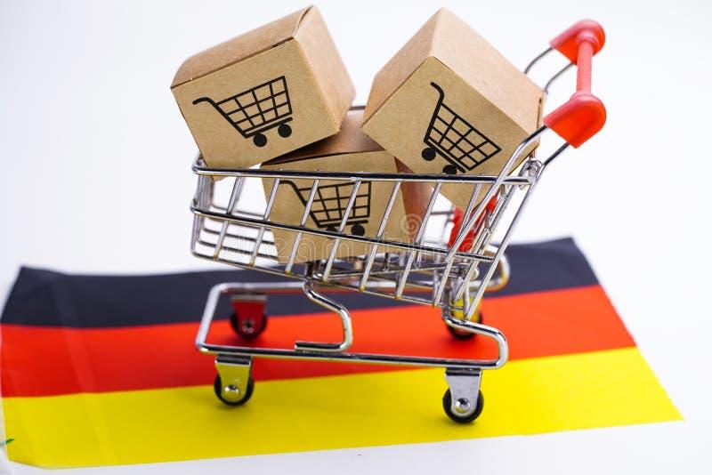 Kasten mit Einkaufswagenlogo und Deutschland-Flagge: Import-export, der online kaufen oder Zustelldienst-Speicherproduktverschiff stockbilder