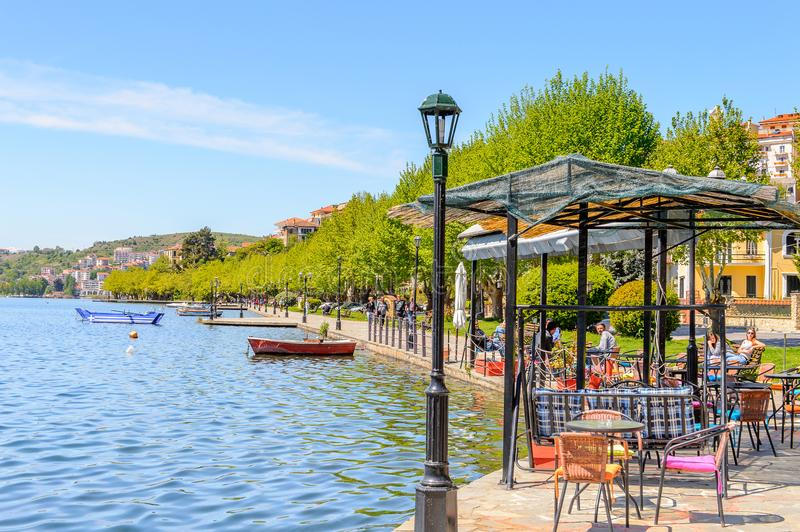Architecture of Kastoria, West Macedonia, Greece. KASTORIA, GREECE - APR 21, 2016: Shore of the Lake Orestiada in Kastoria, West Macedonia, Greece. The town is stock photo